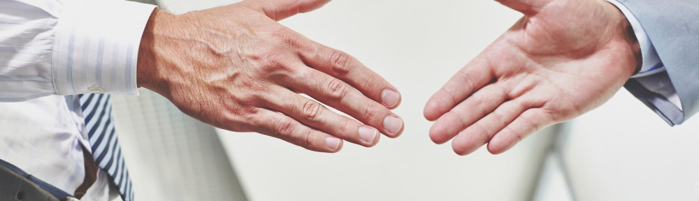 Photo of hands of business partners before handshake